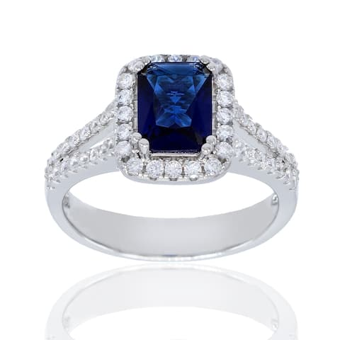 Emerald Cut Simulated Sapphire Cubic Zirconia Center Stone with Clear Cubic Zirconia Halo Set and Pave Set Shank