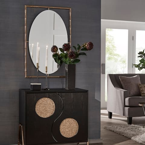 The Curated Nomad Waltham Gold Finish Bamboo Frame Oval Wall Mirror