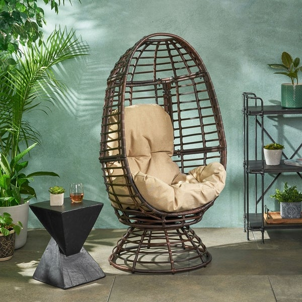 Pitner Outdoor Wicker Swivel Egg Chair with Cushion by Christopher Knight Home. Opens flyout.