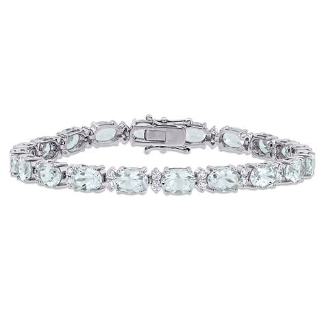 Miadora 18k White Gold Oval Aquamarine and 1 1/10ct TDW Diamond Tennis Bracelet