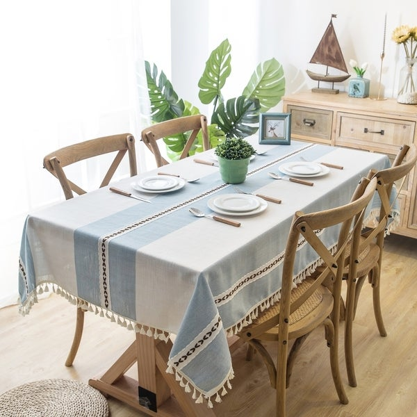 The Curated Nomad Needleridge Blue Cotton and Linen Tablecloth with Tassels. Opens flyout.