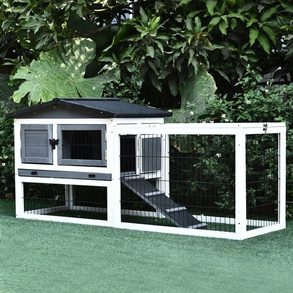 PawHut Solid Wood Rabbit Hutch with 2 House Levels and Patio Space, Strong Black Metal Cage Wire, and Easy Clean Tray. Opens flyout.