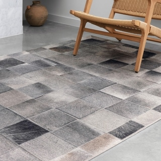 Alexander Home Davide Printed Square Faux Cowhide Area Rug