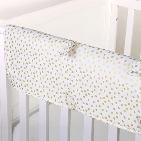 The Peanut Shell Confetti Padded Crib Rail Guard in Gold.