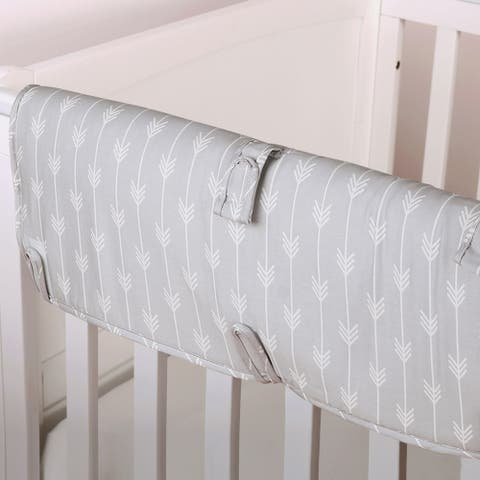 The Peanut Shell Arrow Print Padded Crib Rail Guard in Grey.