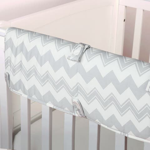 The Peanut Shell Chevron Padded Crib Rail Guard in Grey.