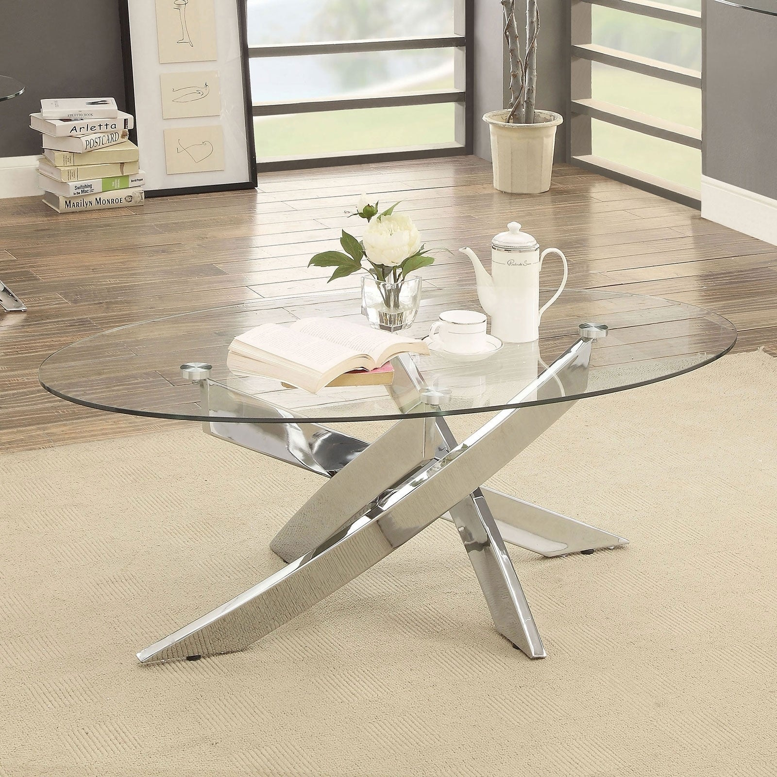 Picture of: Oval Shape Glass Top Coffee Table With Criss Cross Base Silver And Clear Overstock 30922209