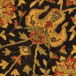 Safavieh Handmade Antiquities Mashad Black/ Ivory Wool Rug (6' Round) - Thumbnail 1