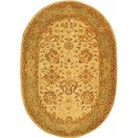 Safavieh Handmade Antiquities Mashad Ivory/ Green Wool Rug (4'6 x 6'6 Oval)