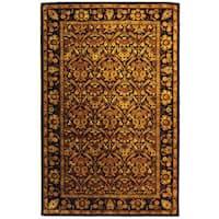 Safavieh Handmade Treasured Dark Plum Wool Rug - 6' x 9'
