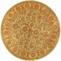Safavieh Handmade Heritage Timeless Traditional Green/ Gold Wool Rug (3'6 Round)