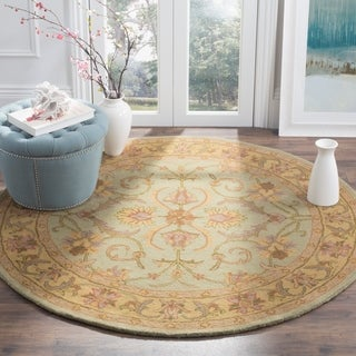 Safavieh Handmade Heritage Timeless Traditional Green/ Gold Wool Rug (6' Round)