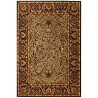 Safavieh Handmade Heritage Timeless Traditional Blue/ Red Wool Rug - 4' x 6'