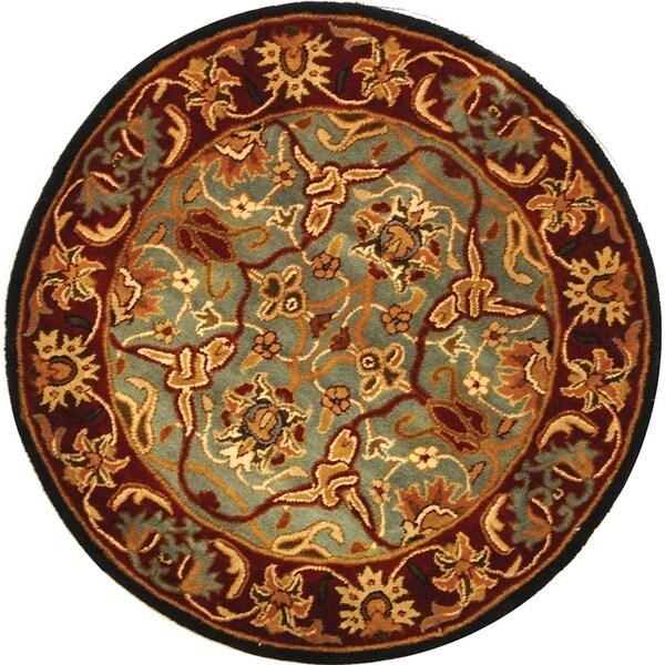 Safavieh Handmade Heritage Timeless Traditional Blue/ Red Wool Rug - 6' x 6' Round