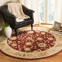 Safavieh Handmade Heritage Traditional Kashan Burgundy/ Beige Wool Rug - 6' x 6' Round