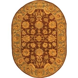 Safavieh Handmade Heritage Traditional Kerman Brown/ Blue Wool Rug (7' 6 x 9' 6 Oval)