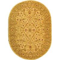 "Safavieh Handmade Treasure Ivory/ Brown Wool Rug - 7'6"" x 9'6"" oval"