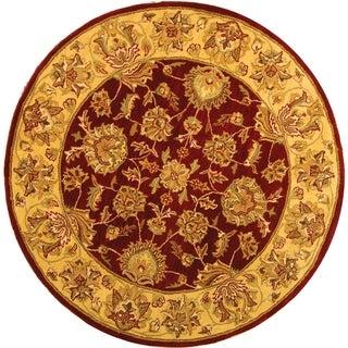 Safavieh Handmade Heritage Traditional Kerman Red/ Gold Wool Rug (6' Round)