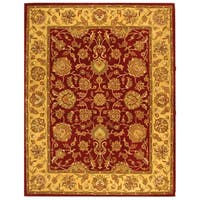 Safavieh Handmade Heritage Traditional Kerman Red/ Gold Wool Rug - 8'3 x 11'