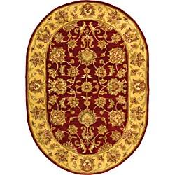 "Safavieh Handmade Heritage Traditional Kerman Red/ Gold Wool Rug - 4'6"" x 6'6"" oval"
