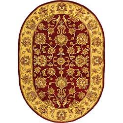 Safavieh Handmade Heritage Traditional Kerman Red/ Gold Wool Rug (4'6 x 6'6 Oval)