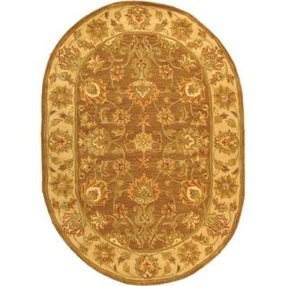 Safavieh Handmade Heritage Traditional Kerman Brown/ Ivory Wool Rug (4'6 x 6'6 Oval)