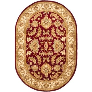 Safavieh Handmade Heritage Traditional Kashan Red/ Ivory Wool Rug (4'6 x 6'6 Oval)