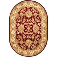"Safavieh Handmade Heritage Traditional Kashan Red/ Ivory Wool Rug - 4'6"" x 6'6"" oval"