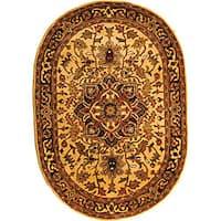 "Safavieh Handmade Classic Heriz Gold/ Red Wool Rug - 4'6"" x 6'6"" oval"