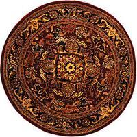Safavieh Handmade Classic Heriz Red/ Navy Wool Rug - 6' x 6' Round
