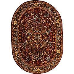 Safavieh Handmade Classic Heriz Red/ Navy Wool Rug (7'6 x 9' Oval)