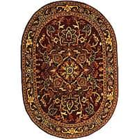 "Safavieh Handmade Classic Heriz Red/ Navy Wool Rug - 7'-6"" X 9'-6"" Oval"