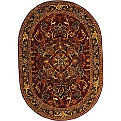 "Safavieh Handmade Classic Heriz Red/ Navy Wool Rug - 7'6"" x 9'6"" oval"