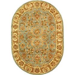 Safavieh Handmade Heritage Timeless Traditional Blue/ Beige Wool Rug (4'6 x 6'6 Oval)