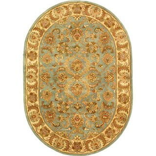 Safavieh Handmade Heritage Timeless Traditional Blue/ Beige Wool Rug (4'6 x 6'6 Oval)