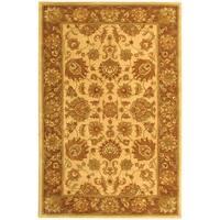 Safavieh Handmade Heritage Traditional Kerman Ivory/ Brown Wool Rug - 4' x 6'