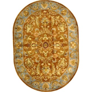 Safavieh Handmade Heritage Timeless Traditional Brown/ Blue Wool Rug (4'6 x 6'6 Oval)