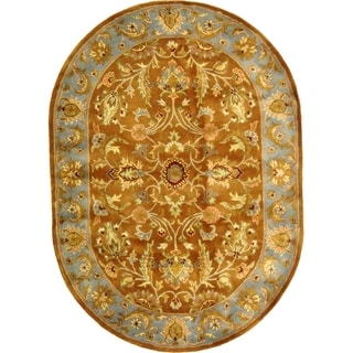 Safavieh Handmade Heritage Timeless Traditional Brown/ Blue Wool Rug (7'6 x 9'6 Oval)