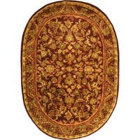 "Safavieh Handmade Exquisite Wine/ Gold Wool Rug - 7'-6"" x 9'-6"" oval"