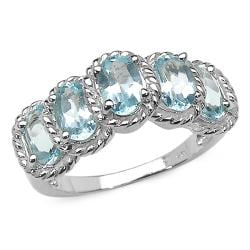 Malaika Sterling Silver Oval-cut Blue Topaz Rope Detail Ring