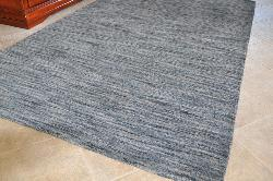 Hand-tufted Mixed Grey Abrash Wool Rug (5' x 8') - Thumbnail 1