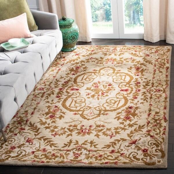 Safavieh Handmade Classic Ivory Wool Rug - 8'3 x 11'
