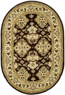 Safavieh Handmade Heritage Timeless Traditional Black/ Ivory Wool Rug (4'6 x 6'6 Oval)