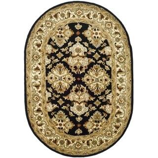 Safavieh Handmade Heritage Timeless Traditional Black/ Ivory Wool Rug (7'6 x 9'6 Oval)