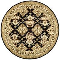 Safavieh Handmade Heritage Timeless Traditional Black/ Ivory Wool Rug (6' Round)