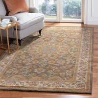 Safavieh Handmade Heritage Timeless Traditional Taupe/ Ivory Wool Rug - 5' x 8'