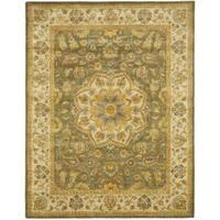Safavieh Handmade Heritage Timeless Traditional Taupe/ Ivory Wool Rug - 8'3 x 11'