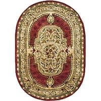 "Safavieh Handmade Classic Burgundy/ Beige Wool Rug - 7'6"" x 9'6"" oval"
