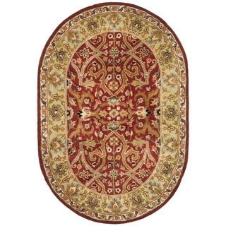 Safavieh Handmade Heritage Timeless Traditional Red/ Gold Wool Rug (4'6 x 6'6 Oval)