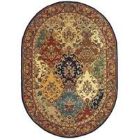 "Safavieh Handmade Heritage Lyra Traditional Multi/ Burgundy Wool Rug - 4'6"" x 6'6"" Oval"